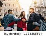 rear view of friends walking... | Shutterstock . vector #1335365534