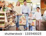 family with children in shop | Shutterstock . vector #133540025