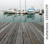 Wood Platform Beside Yachts At...