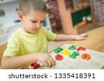 child play alphabet puzzle | Shutterstock . vector #1335418391