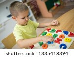 little boy learning letters and ... | Shutterstock . vector #1335418394
