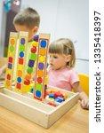 montessori class  kids are... | Shutterstock . vector #1335418397