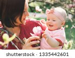 loving mother and baby girl are ... | Shutterstock . vector #1335442601