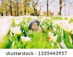 happy smiling baby girl lying... | Shutterstock . vector #1335443957