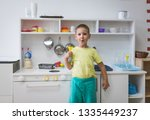 4 year old boy playing with toy ... | Shutterstock . vector #1335449237