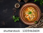 barley soup with carrots ... | Shutterstock . vector #1335463604
