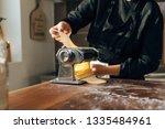 female chef making pasta....   Shutterstock . vector #1335484961
