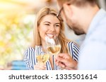 smiling love couple toast  with ... | Shutterstock . vector #1335501614