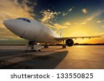 airplane at sunset   back lit | Shutterstock . vector #133550825