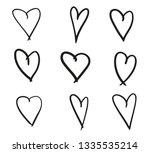 hand drawn grunge hearts on... | Shutterstock . vector #1335535214