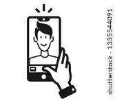 guy takes a selfie icon. simple ... | Shutterstock .eps vector #1335544091
