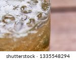 close up of ginger ale fizzing... | Shutterstock . vector #1335548294