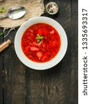 red tomato soup with vegetables ... | Shutterstock . vector #1335693317