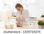 happy young woman preparing... | Shutterstock . vector #1335724274