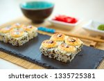 fried sushi roll with shrimp... | Shutterstock . vector #1335725381