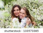 Two Pretty Smiling Women...