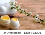 easter eggs stand on wooden... | Shutterstock . vector #1335763301