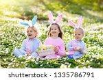 easter egg hunt in spring...   Shutterstock . vector #1335786791