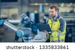 at the factory  automation... | Shutterstock . vector #1335833861