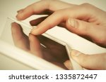 close up of woman using tablet...   Shutterstock . vector #1335872447