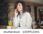 young businesswoman having a... | Shutterstock . vector #1335912341
