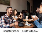 diverse group of young people... | Shutterstock . vector #1335938567