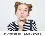 young happy woman over white... | Shutterstock . vector #1336019261