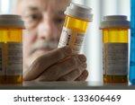 man reading prescription bottle | Shutterstock . vector #133606469