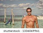 man on sea beach in costa maya  ...   Shutterstock . vector #1336069961