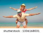 happy couple on summer vacation....   Shutterstock . vector #1336168031