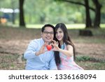 couples holding a heart in... | Shutterstock . vector #1336168094