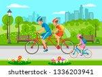 family bike ride through city... | Shutterstock .eps vector #1336203941