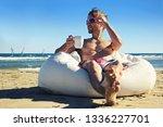 handsome man on summer vacation.... | Shutterstock . vector #1336227701