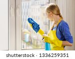 young woman in gloves and apron ... | Shutterstock . vector #1336259351