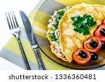 omelet of chicken eggs stuffed... | Shutterstock . vector #1336360481