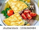 omelet of chicken eggs stuffed... | Shutterstock . vector #1336360484