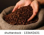 Coffee Beans In Hands On Dark...