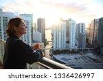 woman in bathrobe drinking her...   Shutterstock . vector #1336426997