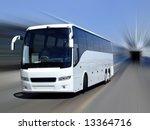 A White Tour Bus Set Against A...