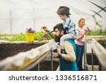 arboretum. greenhouse arboretum. arboretum planting in greenhouse garden. eco arboretum cultivation. happy family in greenhouse