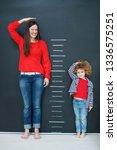 child measure height | Shutterstock . vector #1336575251
