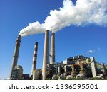 Small photo of Smoke coming from industrial waste, but using new technology to clean it before dispersing