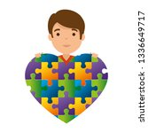 young boy with heart puzzle... | Shutterstock .eps vector #1336649717
