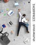 businessman climbs the wall as... | Shutterstock . vector #1336668341