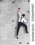 businessman climbs the wall as... | Shutterstock . vector #1336669487