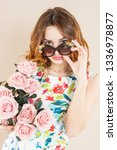 girl with roses in sunglasses.... | Shutterstock . vector #1336978877