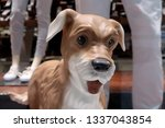 plastic dog in the foreground... | Shutterstock . vector #1337043854