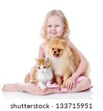 Stock photo girl playing with pets dog and cat looking away isolated on white background 133715951