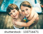 brother and sister hugging in... | Shutterstock . vector #133716671