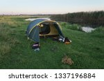 landscape with a tent with a... | Shutterstock . vector #1337196884